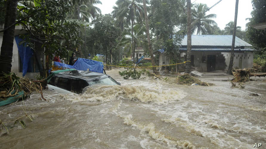 A car is submerged as roads and houses are engulfed in water following heavy rain and landslide in Kozhikode, Kerala state, India, Aug. 9, 2018.
