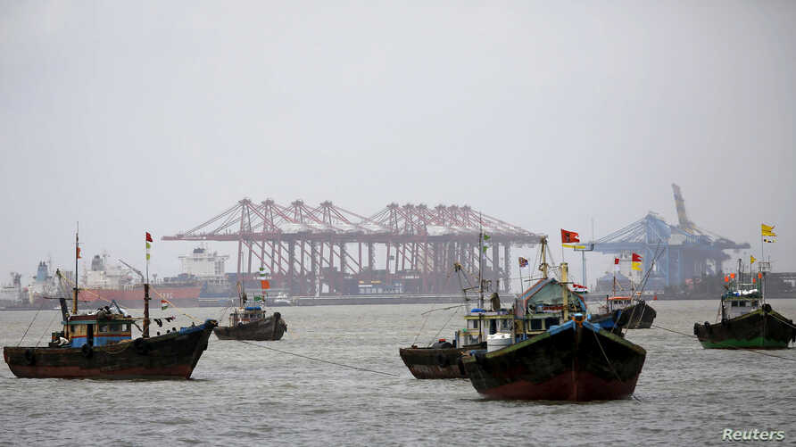 FILE - Fishing trawlers are seen in front of the Jawaharlal Nehru Port Trust (JNPT) in Mumbai, India.