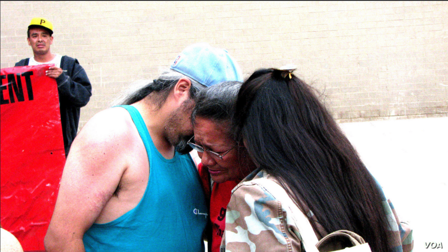 Lynn Eagle Feather, mother of police shooting victim Paul Castaway, is consoled by friends at rally in Denver, Co., July 12, 2015.  (Courtesy/Steve Stalzle)