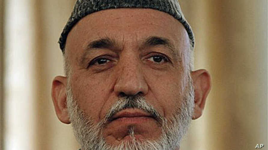 Afghan President Hamid Karzai listens during a press conference in Kabul, Afghanistan, 25 Oct 2010