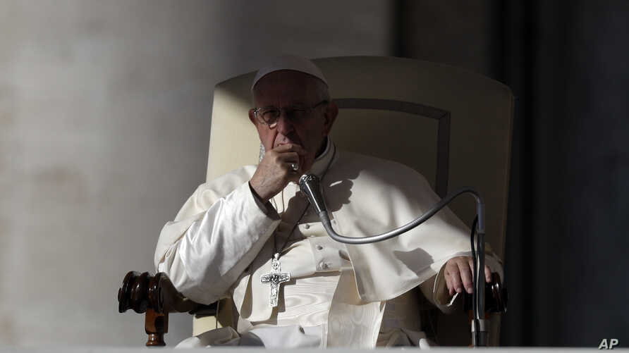 Pope Francis listens to the welcome speeches during his weekly general audience in St. Peter's Square at the Vatican, Wednesday, Oct. 24, 2018.