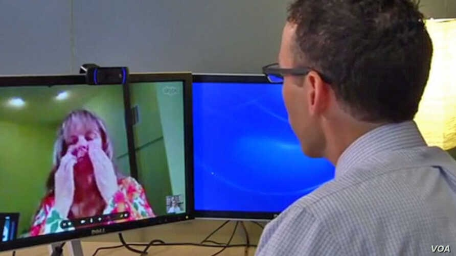 Diana Rae of Tenino, Washington, demonstrates virtual urgent care with Dr. Ben Green in Seattle, who consults with her via Skype. (Courtesy of Franciscan Health System)