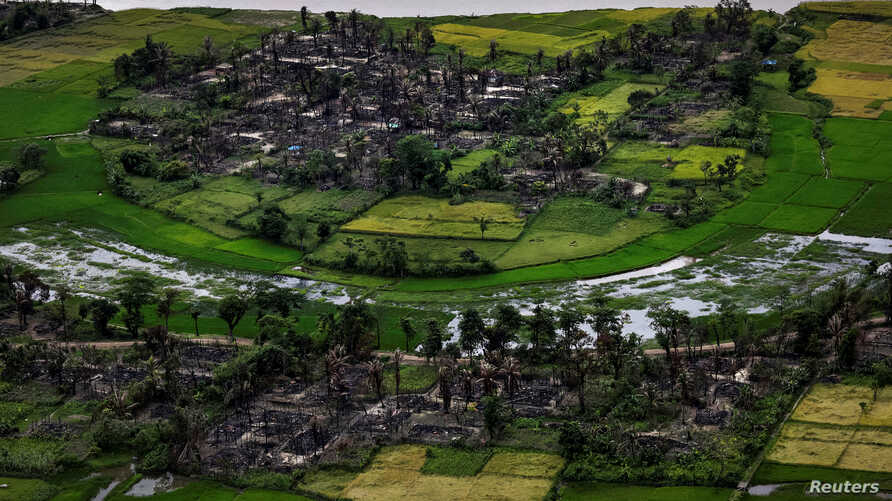 FILE - The remains of a burned Rohingya village is seen in this aerial photograph near Maungdaw, north of Rakhine State, Myanmar Sept. 27, 2017.