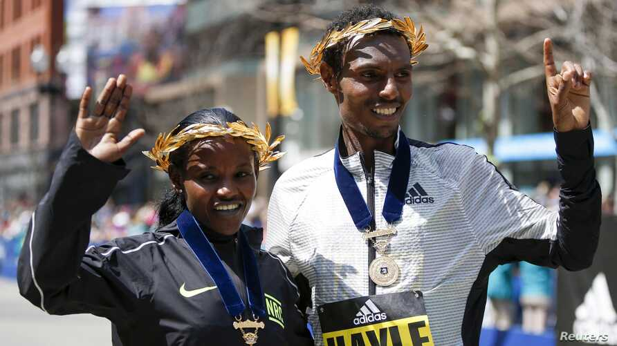 Atsede Baysa and Lemi Berhanu Hayle, both from Ethiopia, pose for a photograph after winning the 120th Boston Marathon, April 18, 2016. Credit: Greg M. Cooper-USA TODAY