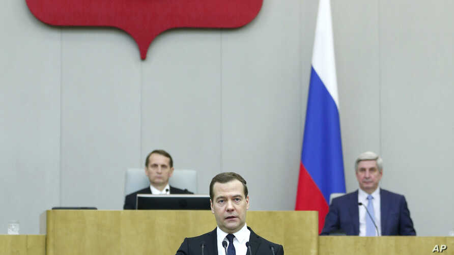 Russian Prime Minister Dmitry Medvedev, foreground, delivers his annual report to lawmakers in the State Duma (lower parliament chamber) in Moscow, Russia, April 21, 2015.