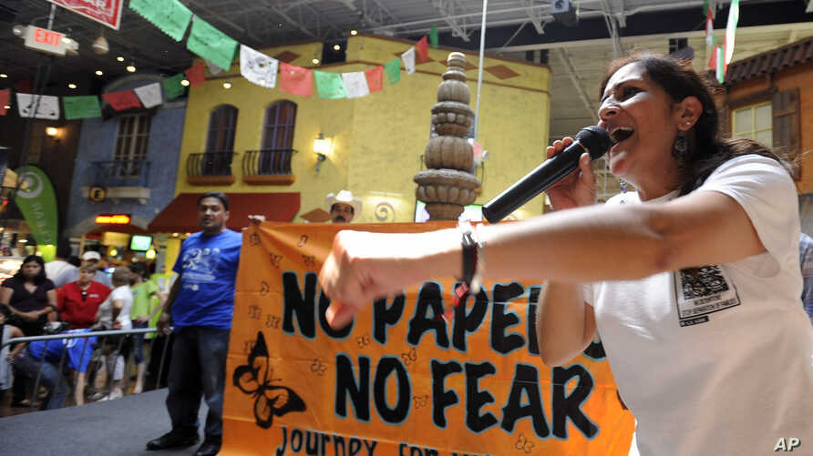 """Georgia Latino Alliance for Human Rights member Adelina Nicholls, of Mexico, joins members of a cross-country group of undocumented immigrants participating in a """"No Papers No Fear"""" event at Fiesta Mall in Atlanta, August 25, 2012."""
