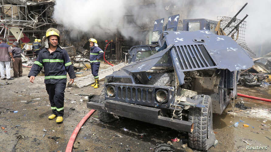 A damaged vehicle of the Iraqi security forces is seen at the site of a car bomb attack in Baghdad al-Jadeeda, an eastern district of the Iraqi capital, June 9, 2016.