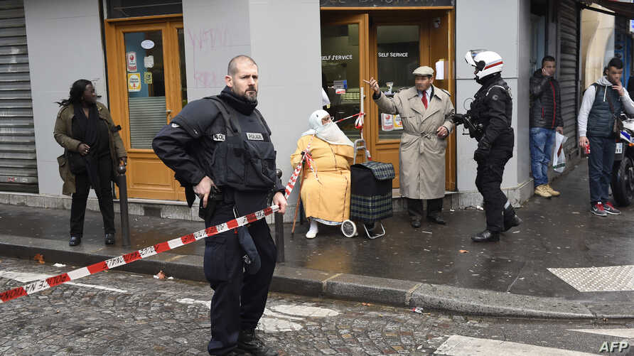 French police patrol near the Boulevard de Barbes in the north of Paris on Jan. 7, 2016, after police shot a man dead as he was trying to enter a police station in the nearby Rue de la Goutte d'Or.