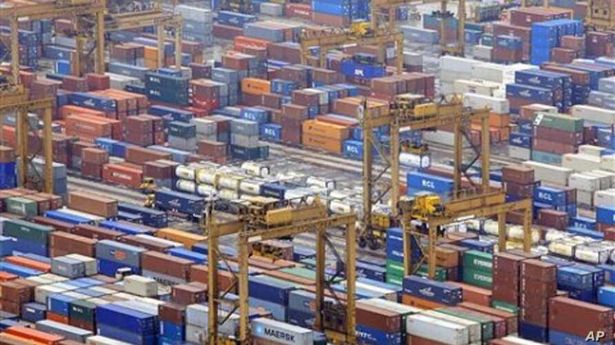 Containers are seen in a port in Singapore. Singapore expects its economy to soar 15 percent this year after a record expansion in the second quarter that suggests Asia's recovery from the global recession remains on track (File)