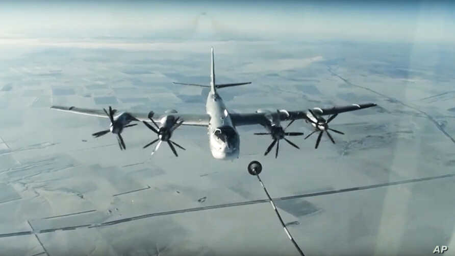 FILE - A Tu-95 strategic Russian bomber is in flight over Syria, from footage taken from Russian Defense Ministry official website, Nov. 17, 2016.