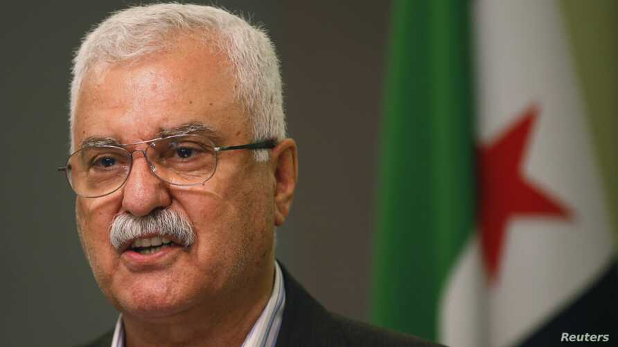 FILE - George Sabra, a veteran Christian opposition figure and acting President of the Syrian National Coalition, speaks during a news conference in Istanbul, May 13, 2013.