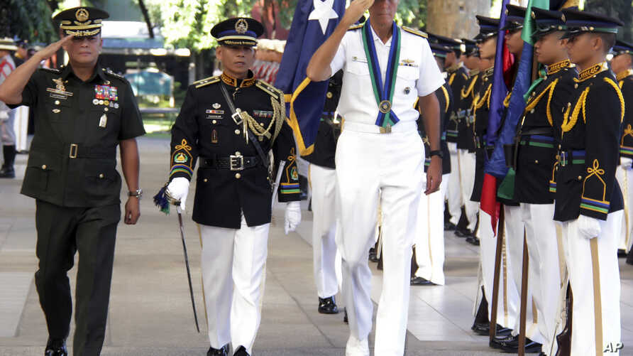 In this photo released by Public Affaires Office, Armed Forces of the Philippines, U.S. Adm. Samuel J Locklear, third from left, commander of the United States Pacific Command, accompanied by Philippine Armed Forces Chief Gen. Gregorio Pio Catapang,
