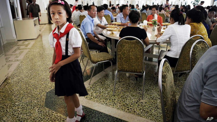 A young North Korean student waits in the dining hall of the Ongnyugwan, a popular noodle restaurant, Sept. 1, 2014 in Pyongyang