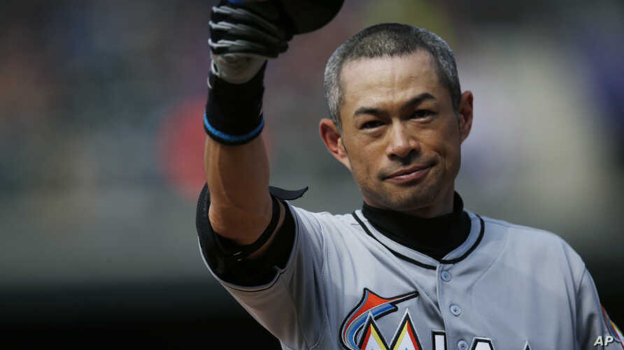 Miami Marlins' Ichiro Suzuki tips his helmet to the crowd as they applaud after he tripled off Colorado Rockies starting pitcher Chris Rusin in the seventh inning of a baseball game, Sunday, Aug. 7, 2016.