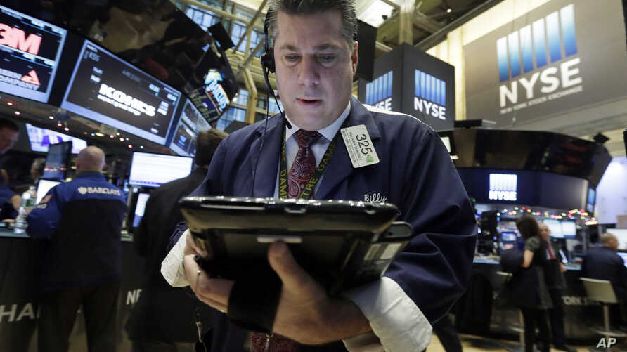 Trader William McInerney works on the floor of the New York Stock Exchange, Jan. 5, 2016.