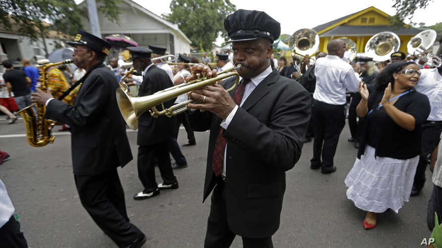 FILE - Musicians are seen participating in a traditional jazz funeral in New Orleans, Louisiana.