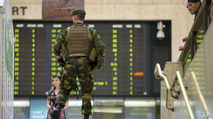 A Belgian Army soldier patrols inside Central Station in Brussels, June 21, 2017.