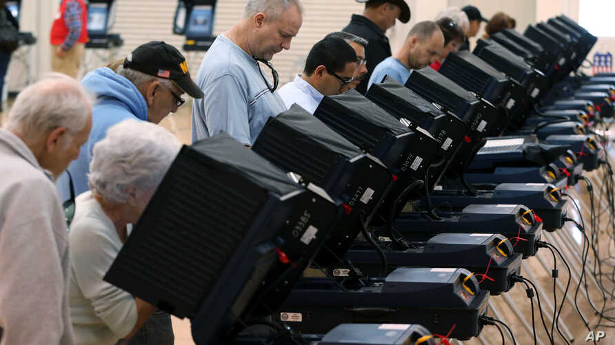 FILE - People cast their ballots in Carson City, Nev., on Nov. 4, 2014.