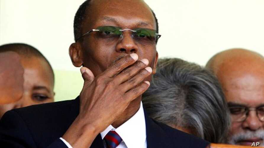 Haiti's former president Jean-Bertrand Aristide blows a kiss after a news conference in Port-au- Prince, March 18, 2011