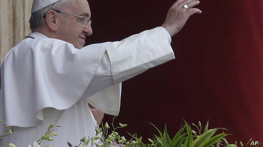 Pope Francis delivers the Urbi et Orbi (to the city and to the world) blessing at the end of the Easter Sunday Mass in St. Peter's Square at the Vatican , April 5, 2015.
