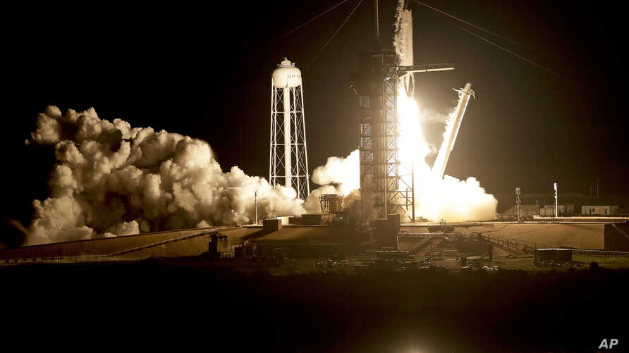 A SpaceX Falcon 9 rocket with a demo Crew Dragon spacecraft lifts off for a test flight to the International Space Station from pad 39A at the Kennedy Space Center in Cape Canaveral, Fla., March 2, 2019. Aboard is one passenger: a life-size test dumm