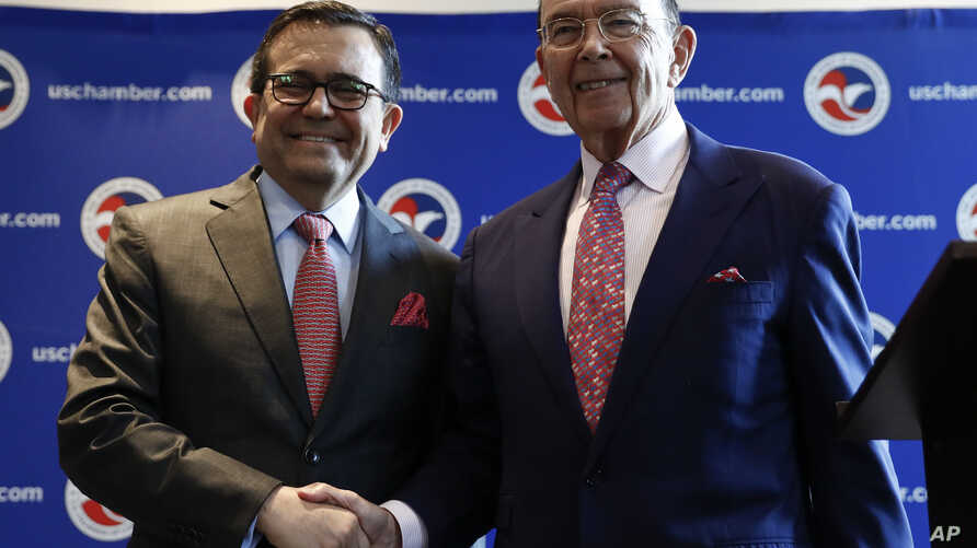 Commerce Secretary Wilbur Ross and Mexico Secretary of the Economy Ildefonso Guajardo Villarreal shake hands after a news conference at the U.S. Chamber of Commerce in Washington, June 6, 2017, about Mexico sugar exports.