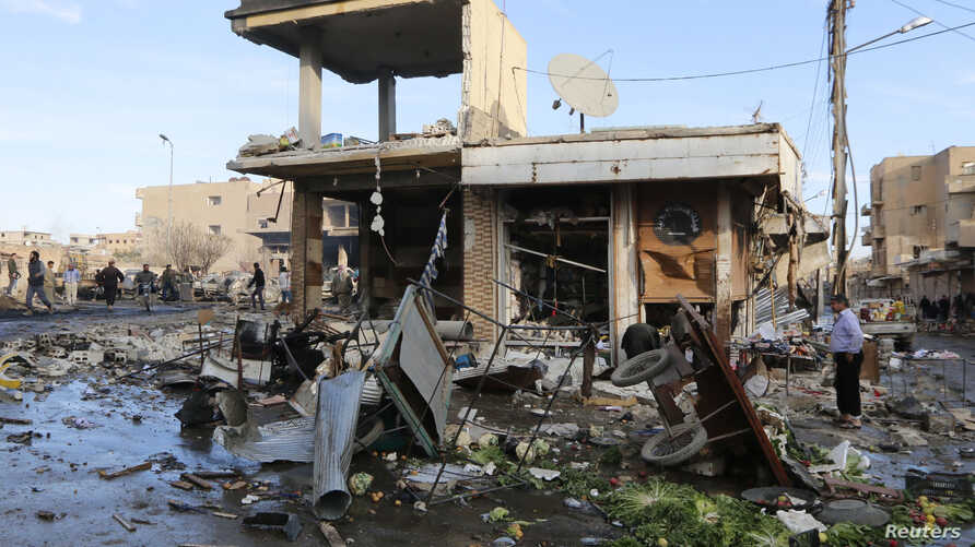 A site hit by what activists said were airstrikes by forces loyal to Syria's President Bashar al-Assad is pictured in Raqqa, Nov. 25, 2014.