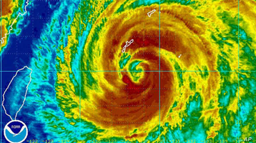 A weather satellite image obtained from the National Oceanic and Atmospheric Administration shows Typhoon Muifa near Okinawa, Japan at 1130 GMT on August 4, 2011