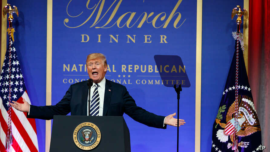 """FILE - President Donald Trump speaks to the National Republican Congressional Committee March Dinner at the National Building Museum in Washington, March 20, 2018. Trump, a constant critic of what he calls """"fake news,"""" will skip the White House Corre"""
