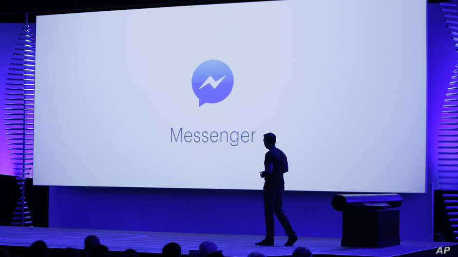 David Marcus, Facebook Vice President of Messaging Products, watches a display showing new features of Messenger during the keynote address at the F8 Facebook Developer Conference in San Francisco.
