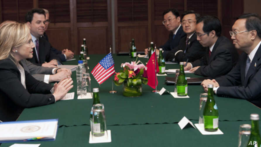 U.S. Secretary of State Hillary Rodham Clinton, left, attends a meeting with Chinese Foreign Minister Yang Jiechi, right, on the sidelines of the Association of Southeast Asian Nations (ASEAN) Ministerial Meeting in Nusa Dua, Indonesia Friday, July 2