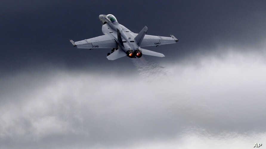 FILE - A F-18 fighter jet flies in display during Farnborough International Airshow, Farnborough, England.