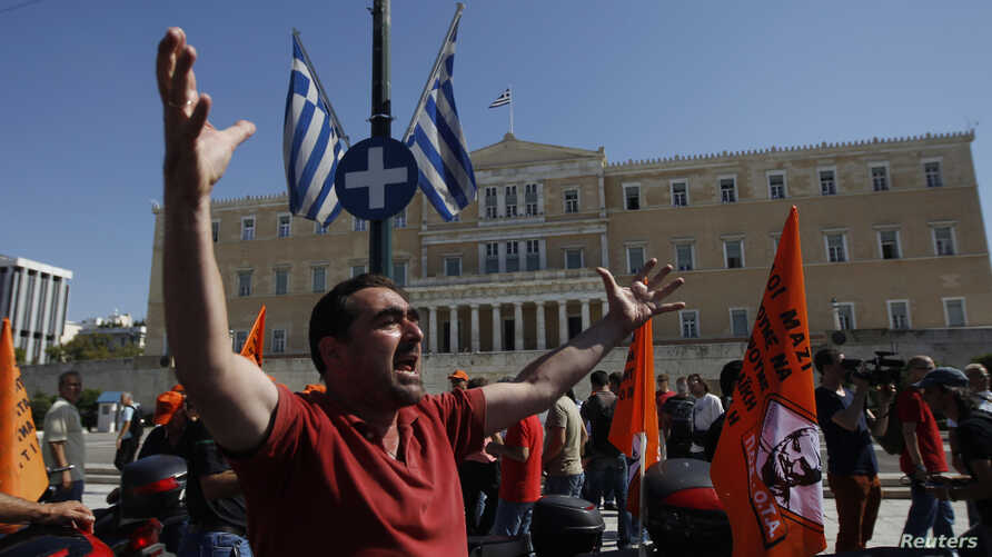 A municipality worker shouts slogans in front of the parliament during a rally against new austerity measures in Athens, October 3, 2012. Greece held a new round of talks with foreign lenders to bridge differences over 2 billion euros of disputed aus