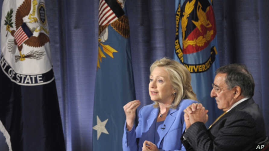 Secretary of State Hillary Rodham Clinton, accompanied by Defense Secretary Leon Panetta, speaks during an event at the National Defense University in Washington, Aug. 16, 2011.