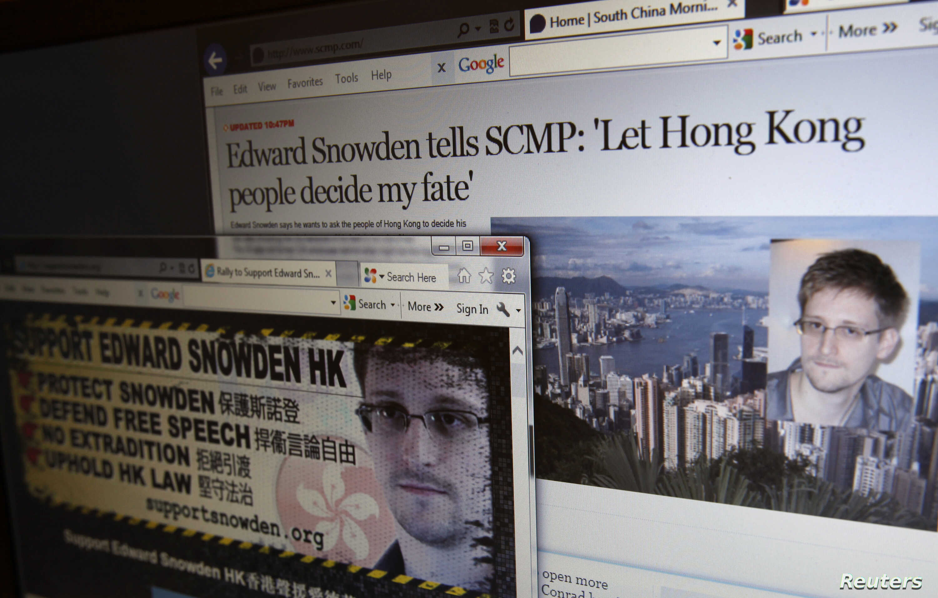 An interview of Edward Snowden by the South China Morning Post newspaper (top) and a website supporting Snowden in Hong Kong, are displayed on a computer screen in Hong Kong in this June 12, 2013 illustration photo.