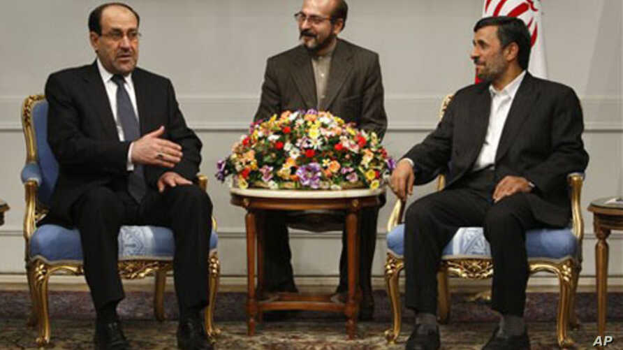 Iraqi Prime Minister Nouri al-Maliki, left, speaks with Iranian President Mahmoud Ahmadinejad, right, during their meeting in Tehran, Iran. Iran gave its clearest nod of support to Iraq's prime minister Monday as he seeks to line up backing from key