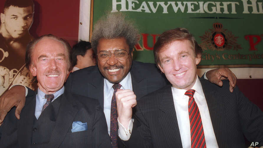 FILE - Donald Trump, right, pictured with his father, Fred Trump, left, and boxing promoter Don King participate in a news conference in Atlantic City, New Jersey, December 1987.