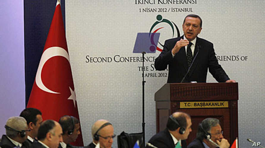 """Turkey's Prime Minister Recep Tayyip Erdogan addresses participants of the """"Friends of Syria"""" conference in Istanbul April 1, 2012."""