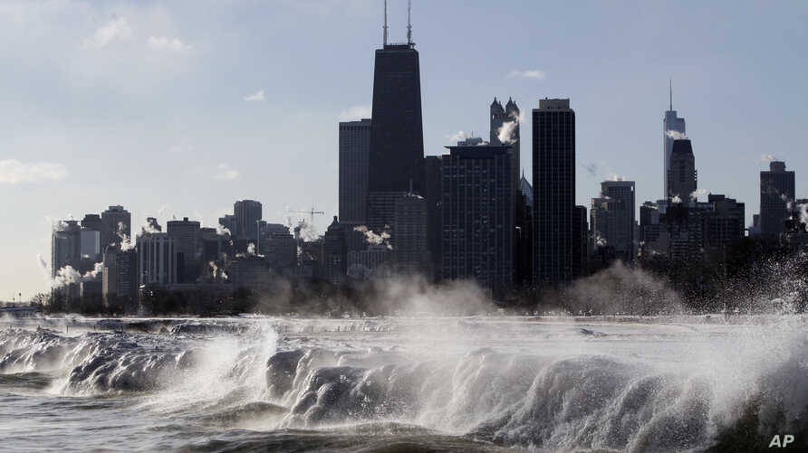 FILE - Ice forms as waves crash along the Lake Michigan shore in Chicago, Illinois, Jan. 27, 2014.
