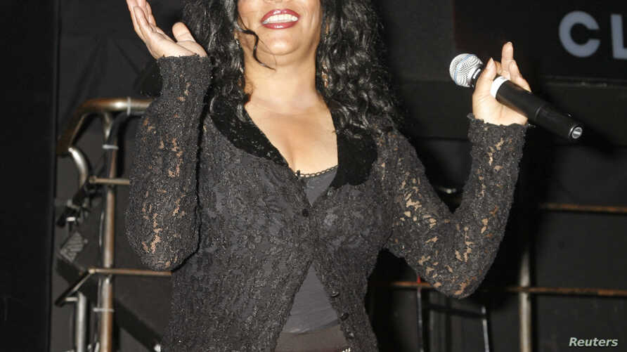FILE - Jone Sledge, one of the original members of Sister Sledge, performs the song 'We Are Family' at the CD launch party for the 'We Are Family' CD and DVD All-Star Katrina benefit CD in Los Angeles, California, Aug. 14, 2006.