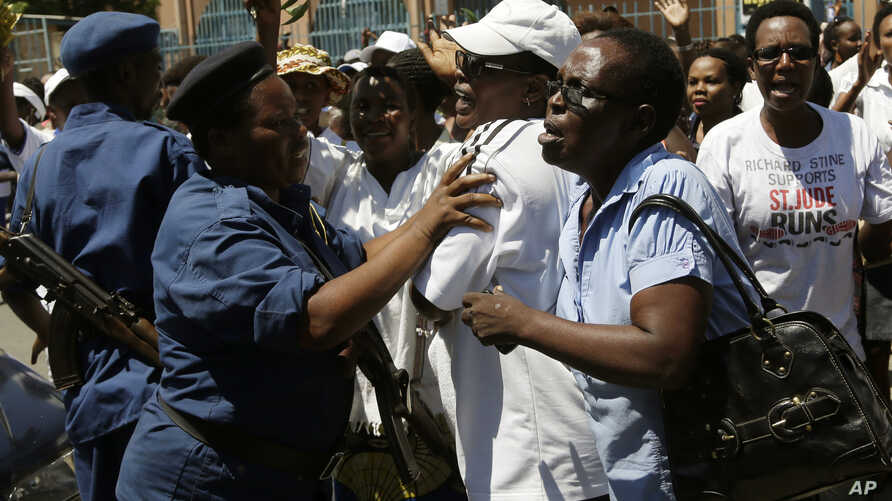 A group of over 250 women march through the center of Bujumbura, Burundi, calling for the release of protesters arrested during demonstrations, Sunday May 10, 2015.