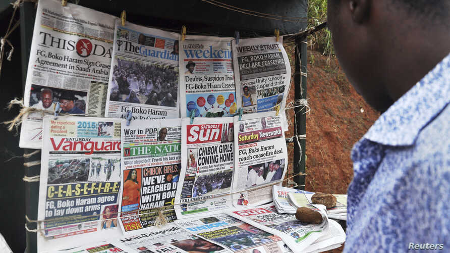 Newspapers with various front page headlines on the Chibok girls and their possible release are displayed at a news stand in Abuja, Nigeria, Oct. 18, 2014.