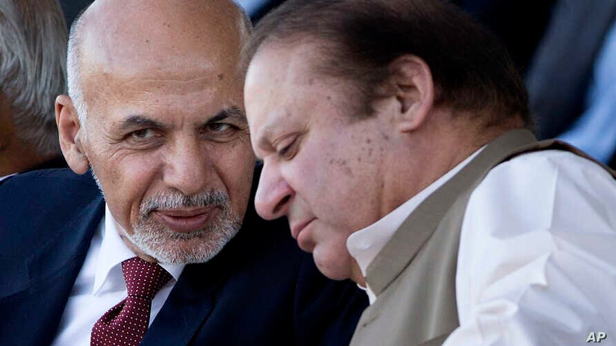 FILE - Afghan President Ashraf Ghani (l) talks with Pakistani Prime Minister Nawaz Sharif in Islamabad, Pakistan. After last week's brutal bombing in Kabul that killed 64 people and wounded 340, an outraged Ghani said he was no longer interested in P