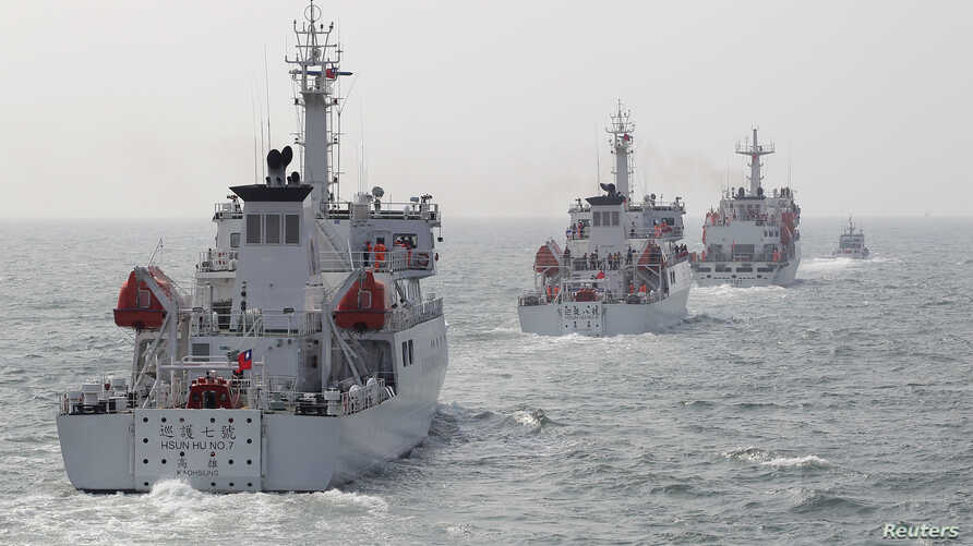 Taiwan Coast Guard patrol ships are seen during a drill held about 30 nautical miles northwest of the port of Kaohsiung, southern Taiwan, March 30, 2013.
