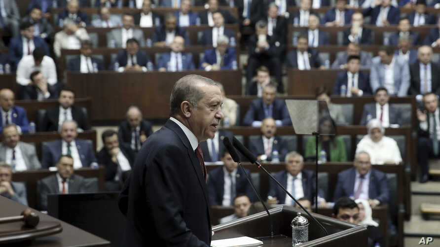 Turkey's President and the leader of ruling Justice and Development Party Recep Tayyip Erdogan addresses his supporters at the parliament in Ankara, Turkey, Tuesday, July 25, 2017. Erdogan has accused Israel of using terrorism as a pretext to take ov