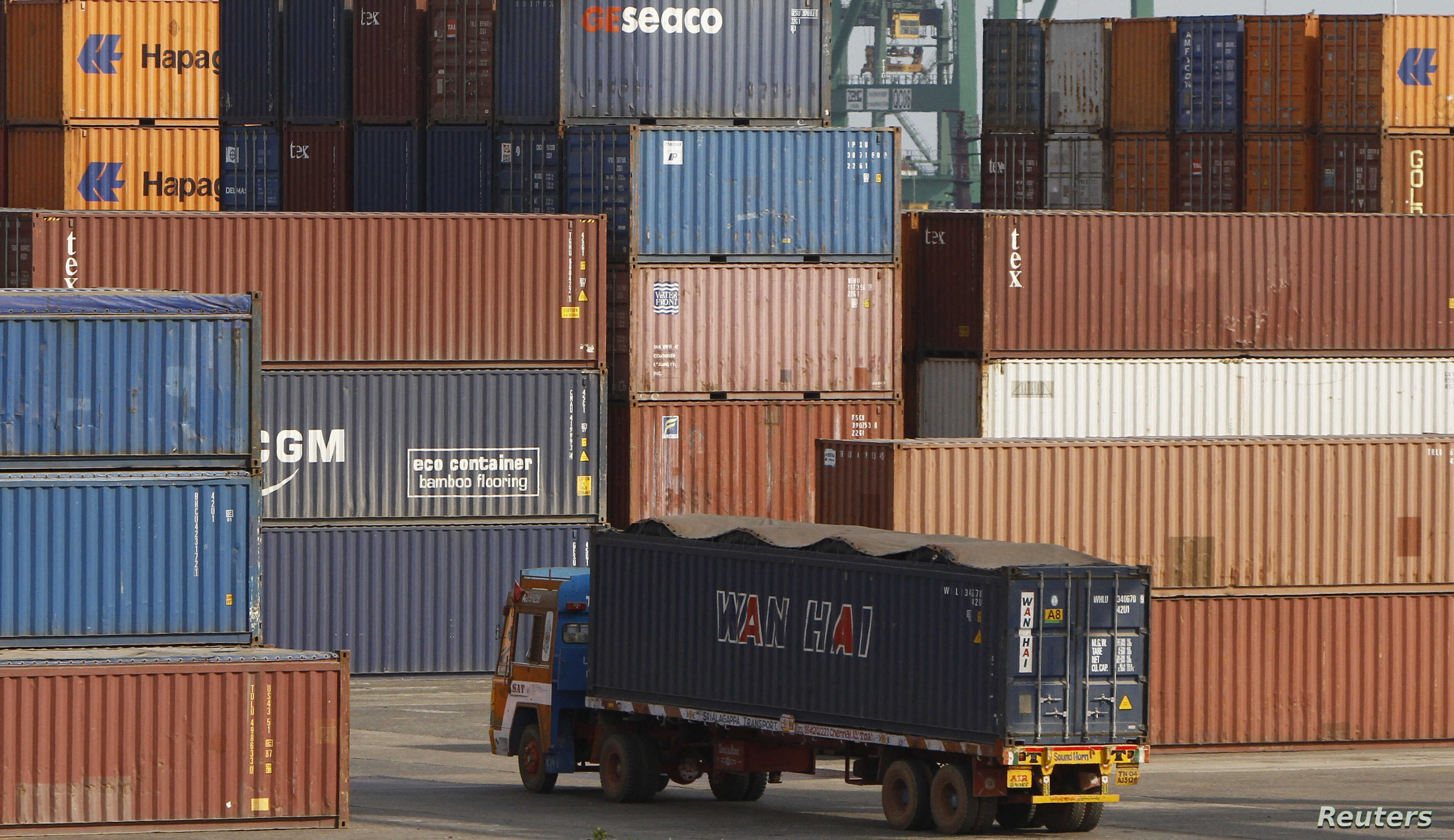 A truck ferries a shipping container at a port in the southern Indian city of Chennai, February 13, 2013.