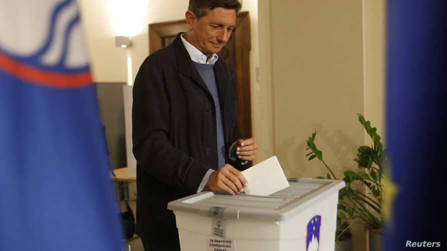 Incumbent President Borut Pahor casts his ballot at a polling station during presidential elections in Sempeter pri Novi Gorici, Slovenia, Oct. 22, 2017.