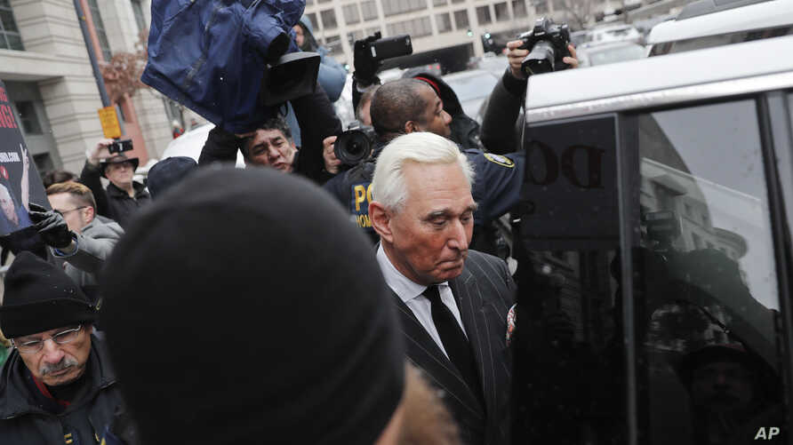 FILE - Former campaign adviser for President Donald Trump, Roger Stone, leaves federal court in Washington, Feb. 1, 2019.