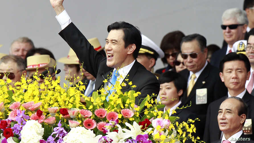 Taiwan's President Ma Ying-jeou raises his fist after giving a speech during National Day celebrations in front of the presidential office in Taipei October 10, 2013.