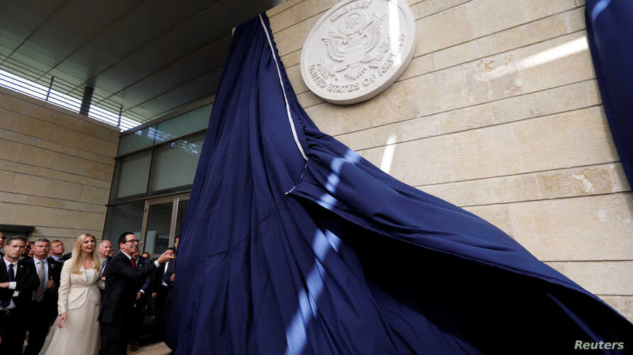 U.S. Treasury Secretary Steven Mnuchin unveils the seal for the new U.S. embassy during the dedication ceremony of the new U.S. embassy in Jerusalem, May 14, 2018.